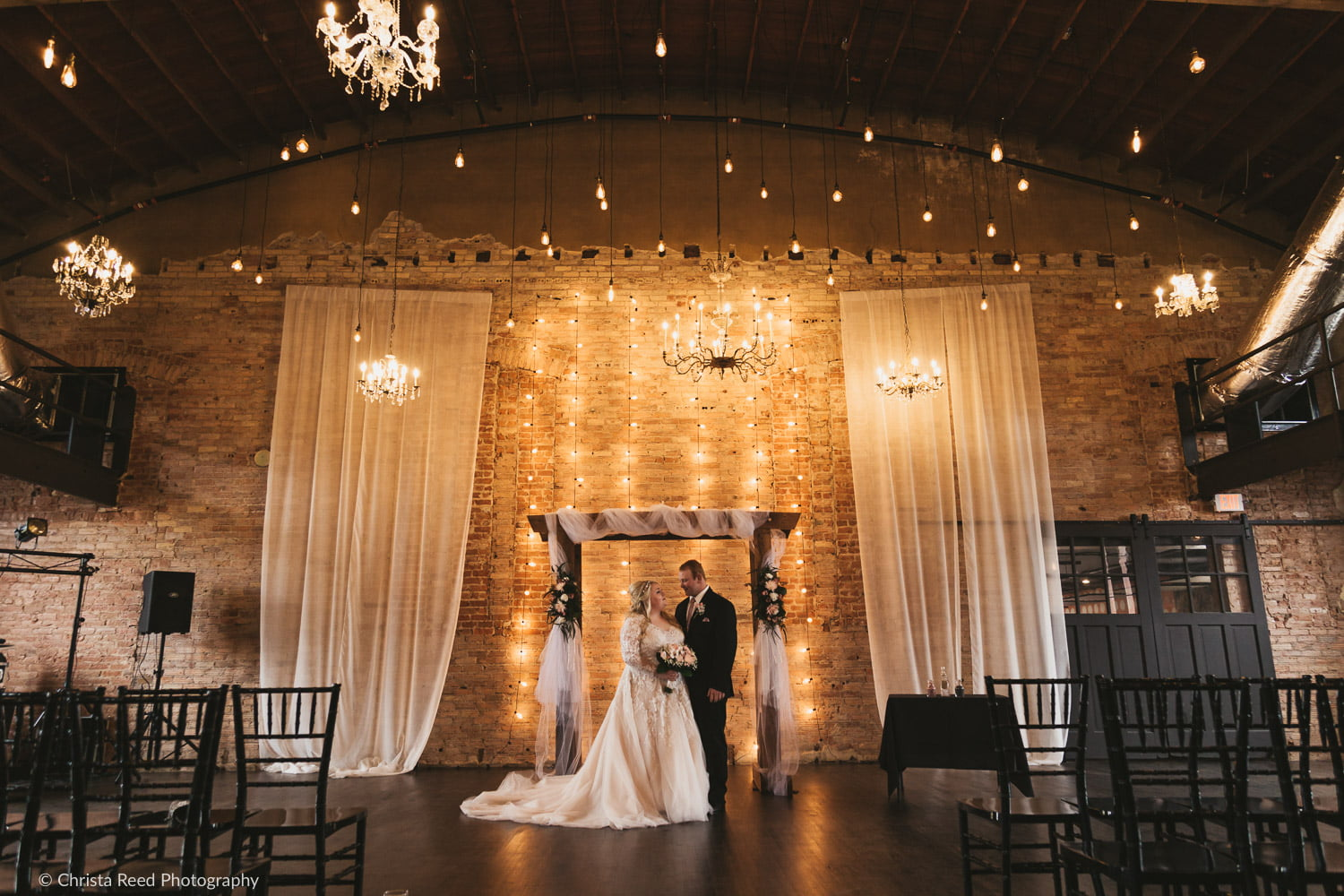 wedding portrait with an arch at the Capitol Room
