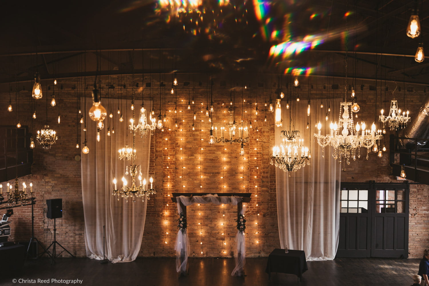 Edison lights hang from the ceiling at the historic Capitol Room wedding venue in St. Peter Minnesota