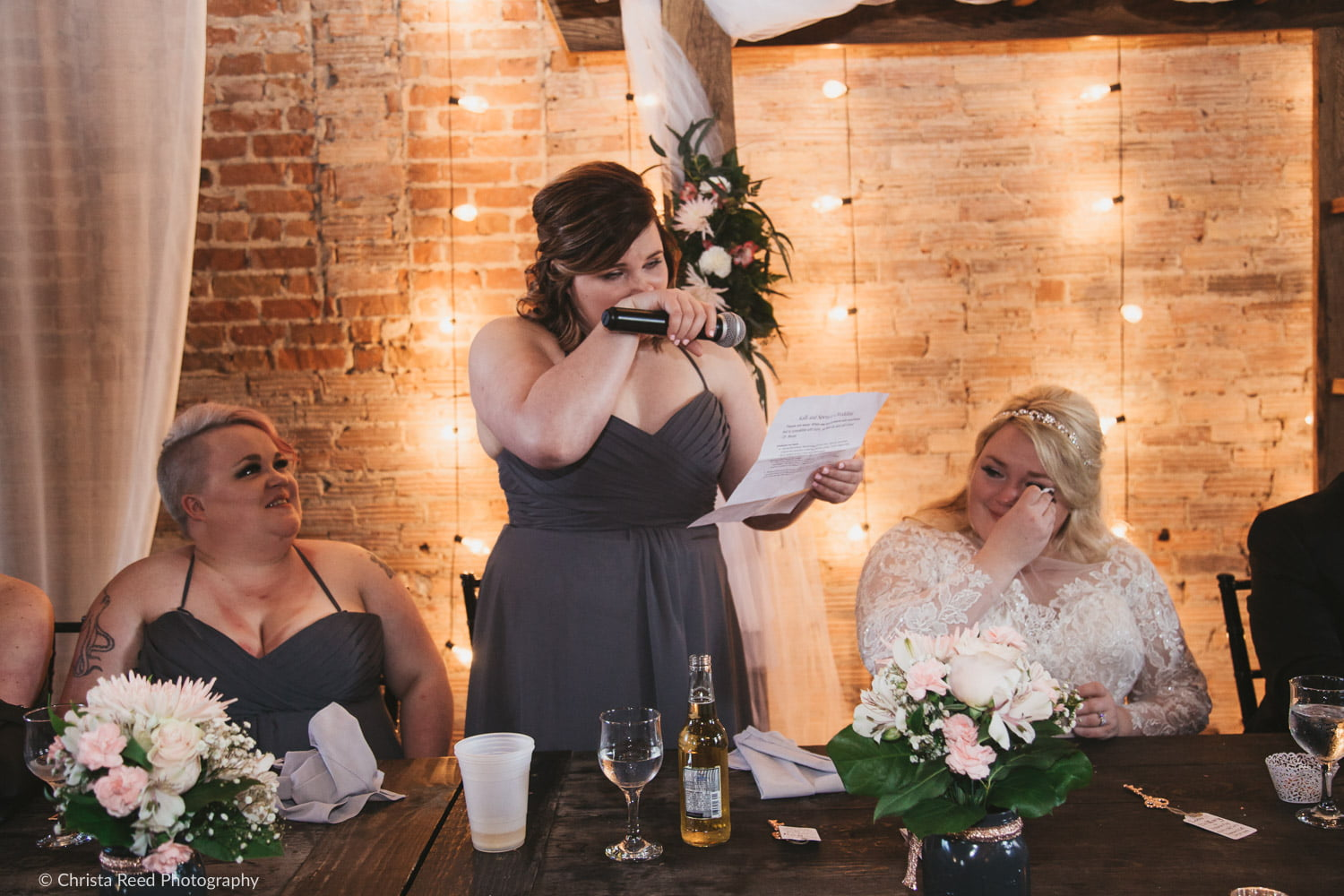 photography of an emotional wedding speech from the maid of honor