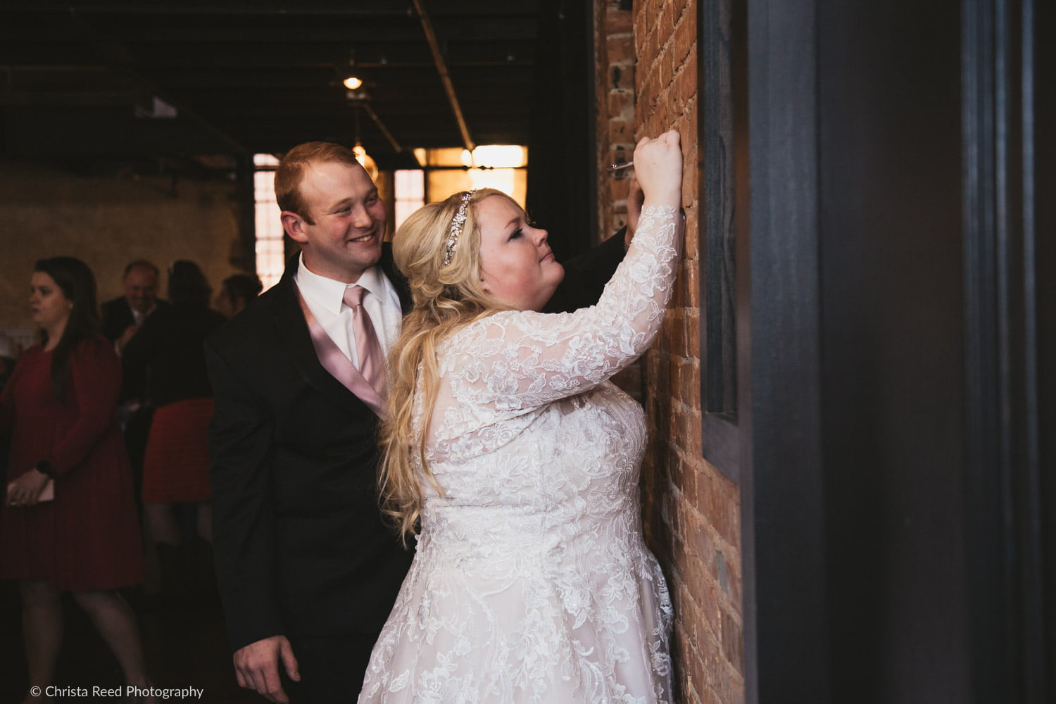 carving your names into brick on your wedding day at the Capitol Room in St. Peter