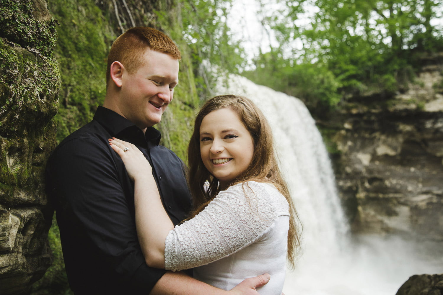 standing by a waterfall for your engagement pictures