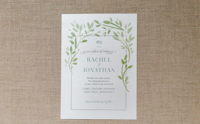 simple water color wedding invitation with floral wreath and ivy