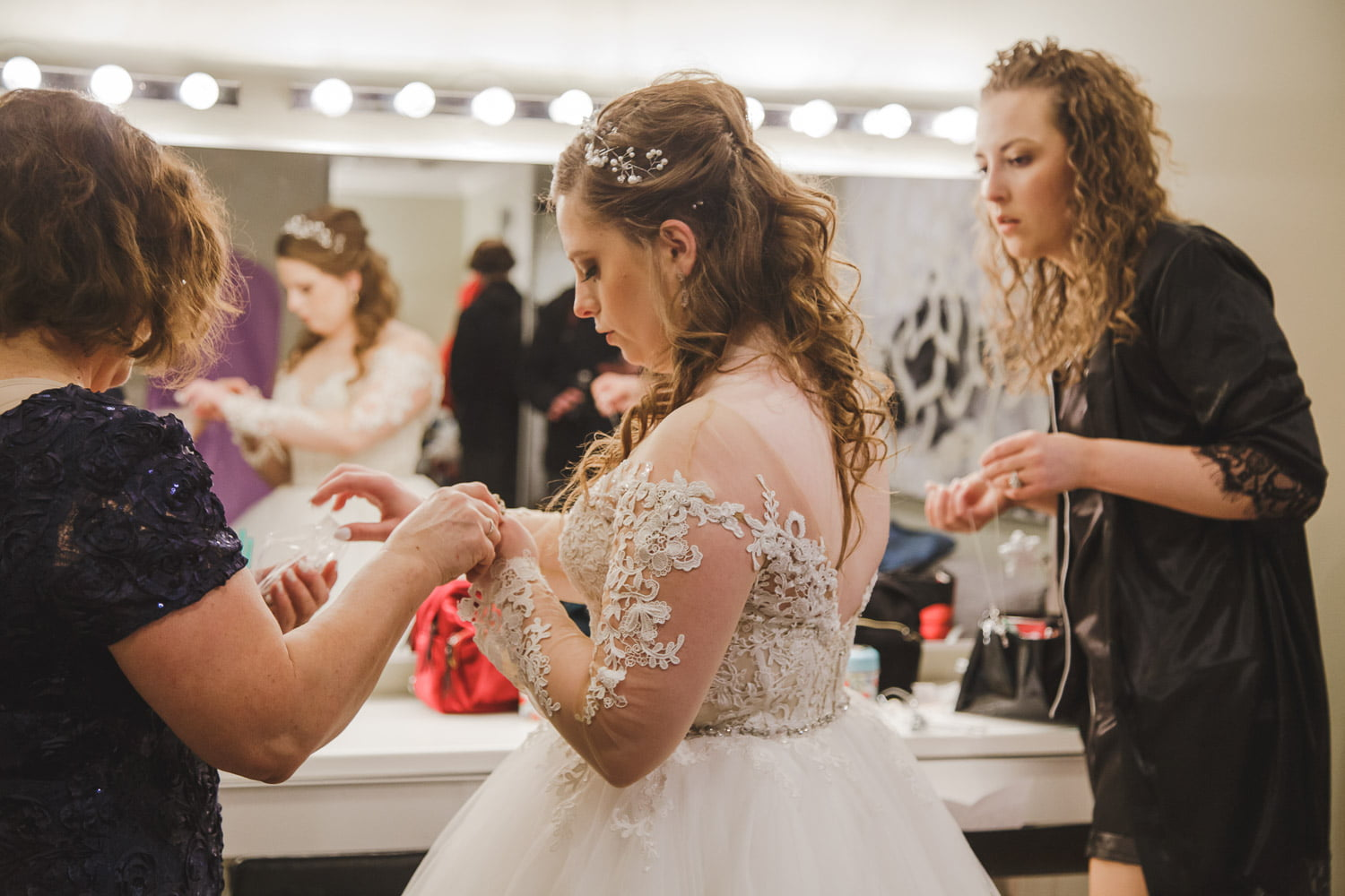 a woman getting ready for her wedding at profile event center