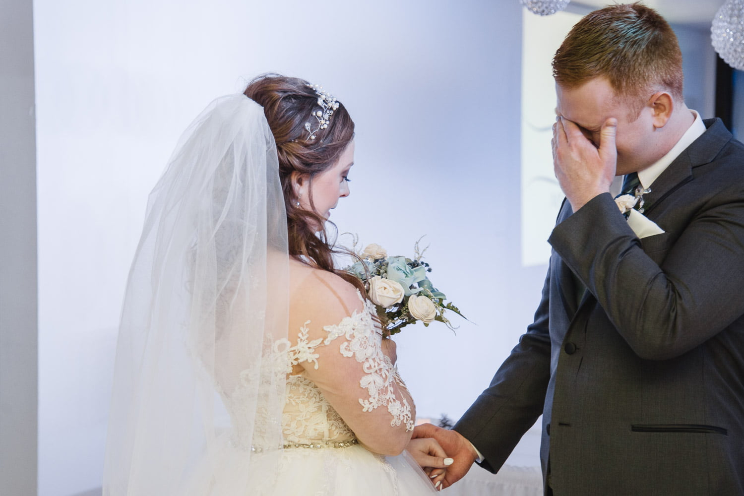 a man cries when he sees his bride for the first time at Profile Event Center in Minneaoplis
