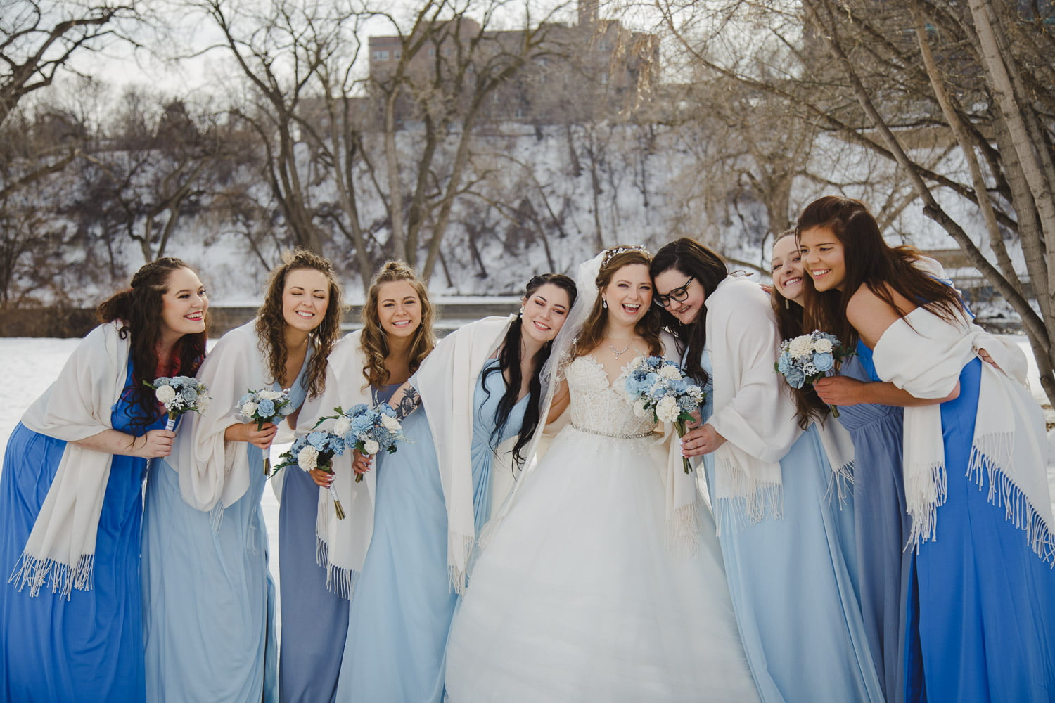 a winter wedding portrait of a bride and her friends in downtown Minneapolis