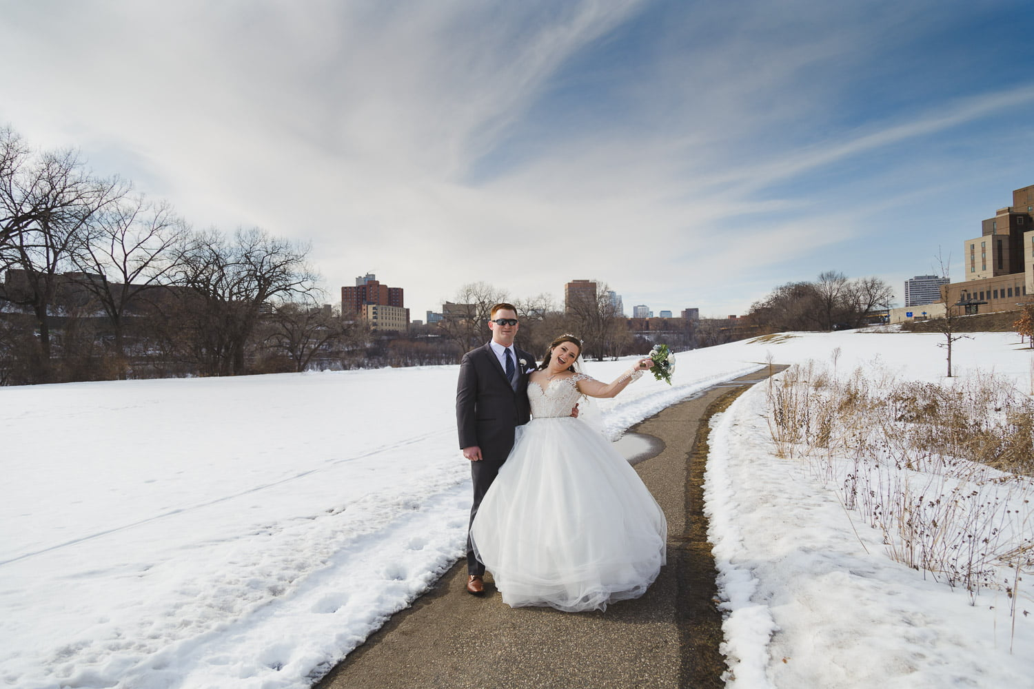 a snowy winter wedding in February with blue sky in Minneapolis