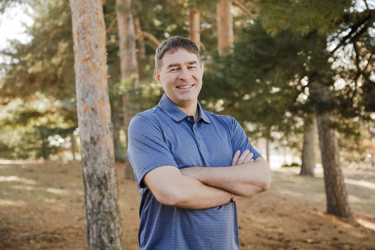 professional headshots in st. paul mn in a grove of pine trees