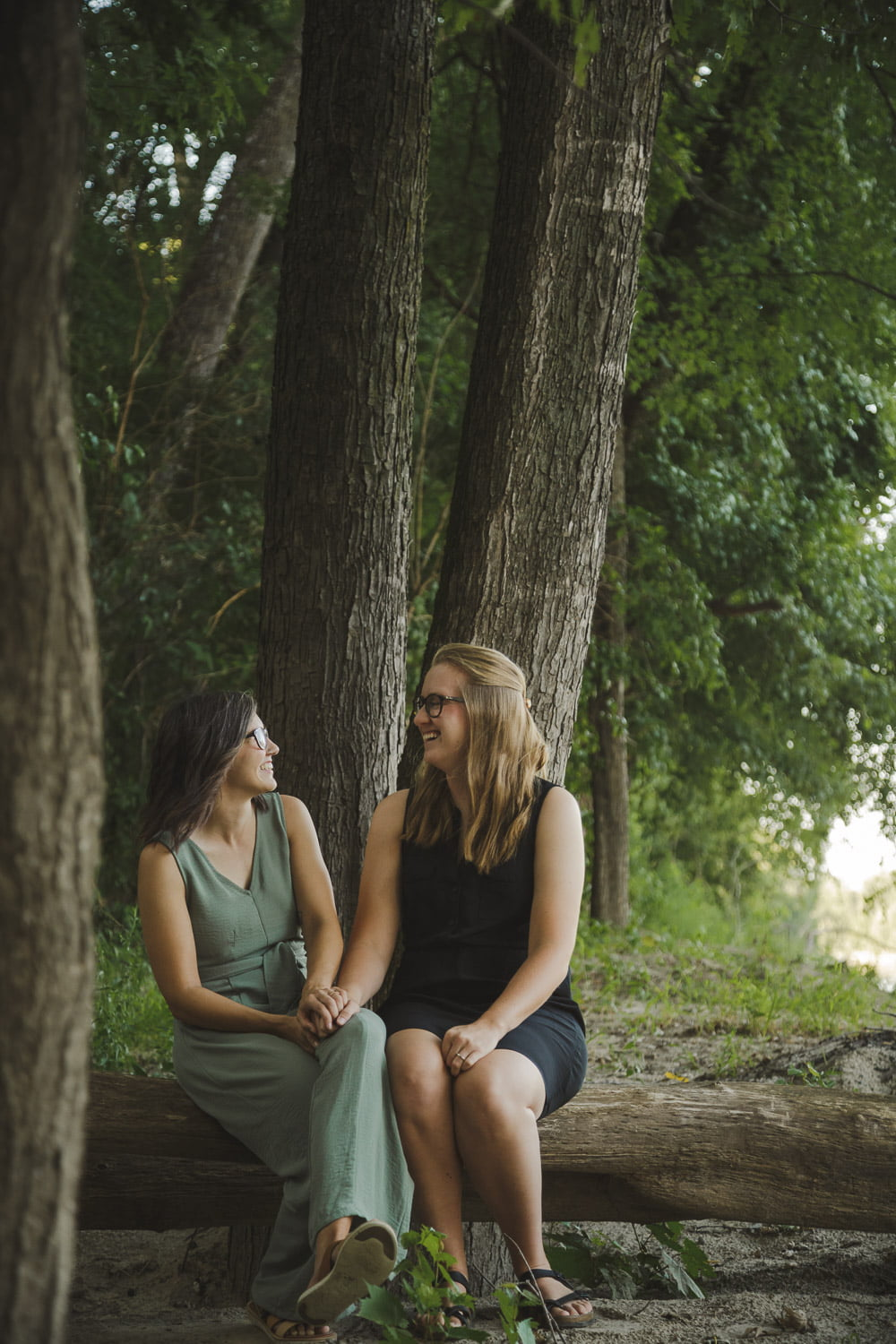 sitting by the river for scenic engagement photos in minnesota