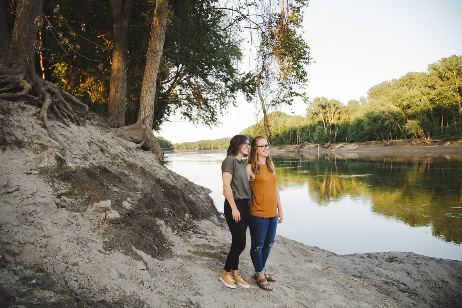a couple stands on the Minnesota River bank for their scenic engagement photos