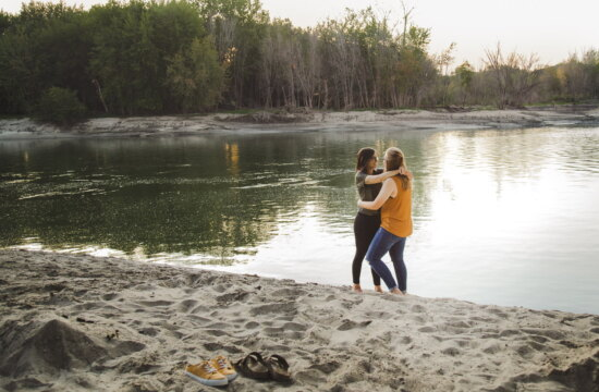 a couple enjoys the sunset along the Minnesota River during a scenic engagement session