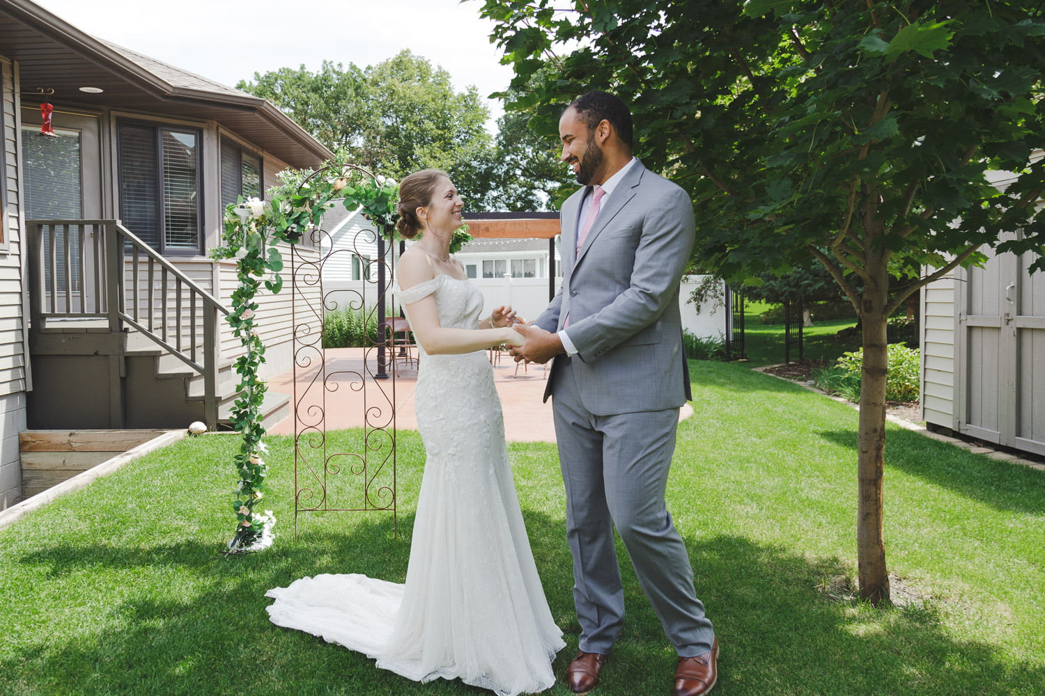 intimate first look backyard wedding