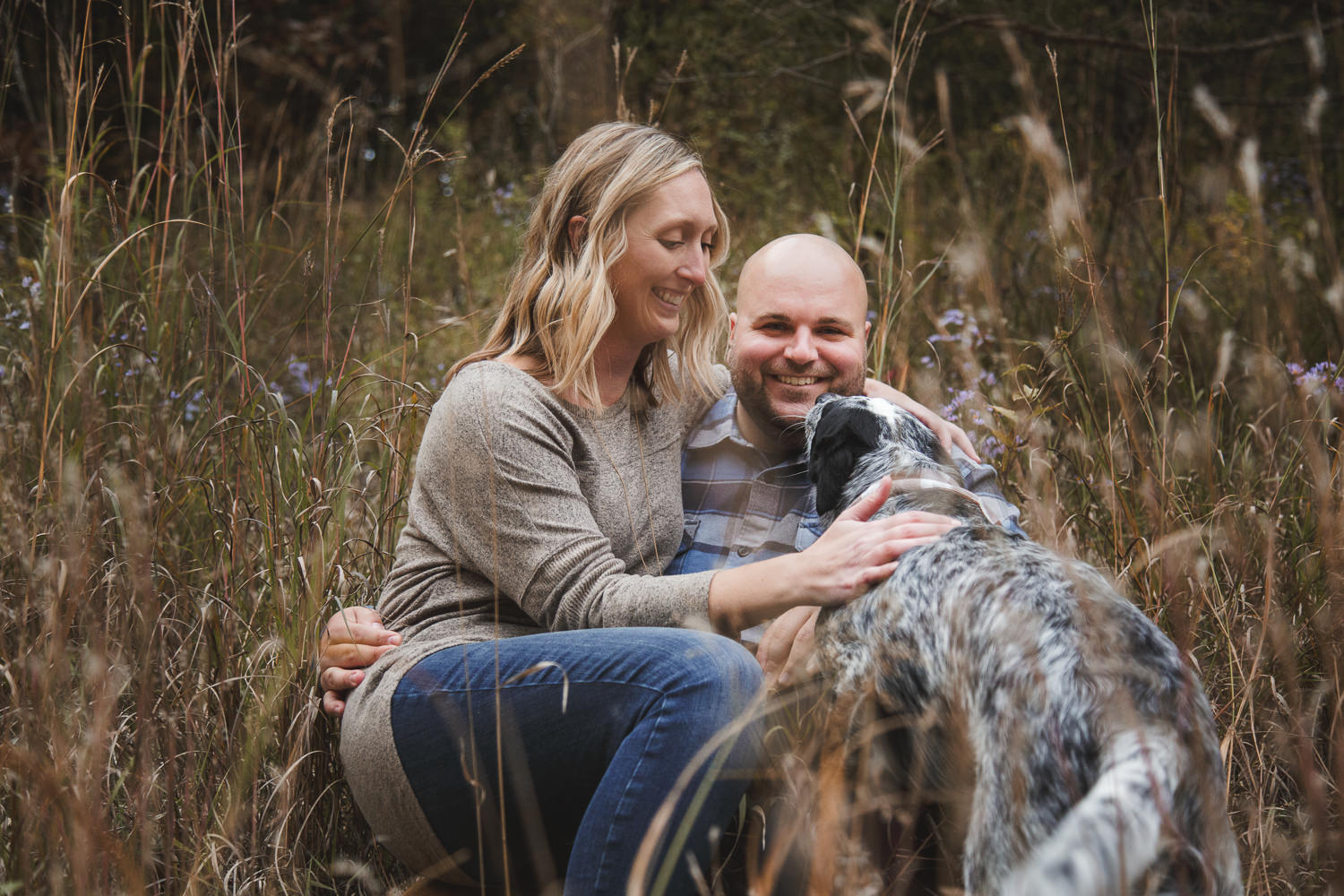 an engagement session in the woods near St. Peter Mn with an adorable dog